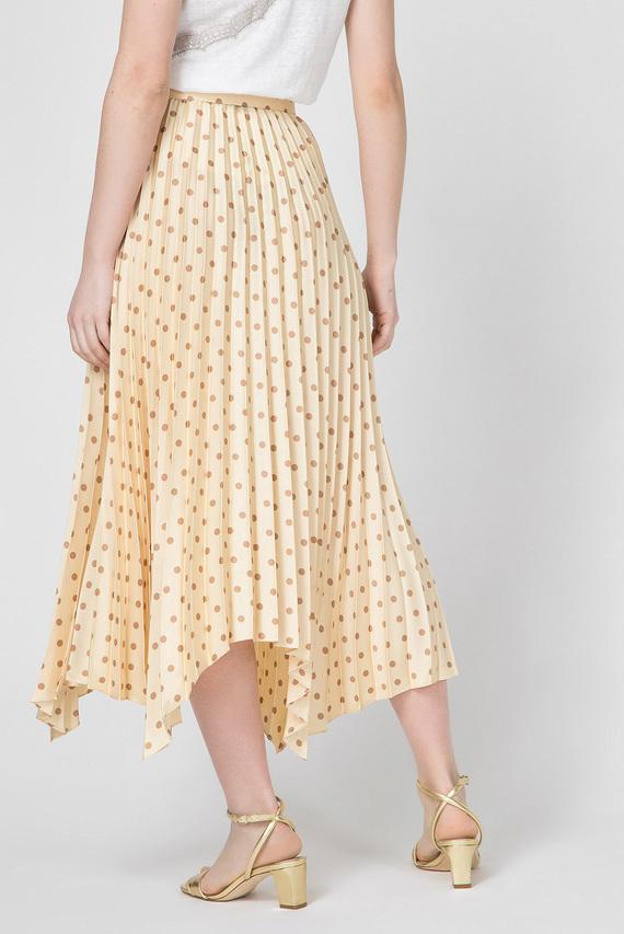 Женская желтая юбка в горошек