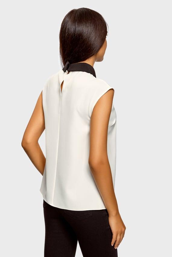 Женская белая блуза без рукавов